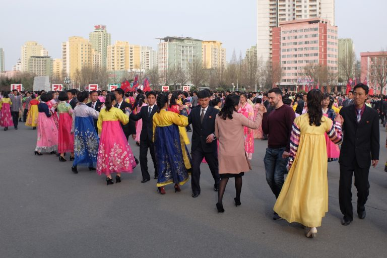 Foreigners partake in a mass dance in Pyongyang, on a North Korea tour