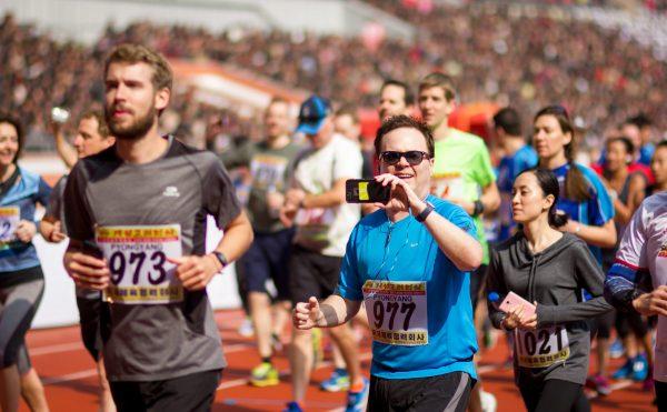 Runners at the beginning of the Pyongyang Marathon tour, North Korea.
