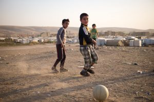 Kids outside a refugee camp in Iraqi Kurdistan on one of our Iraqi Tours