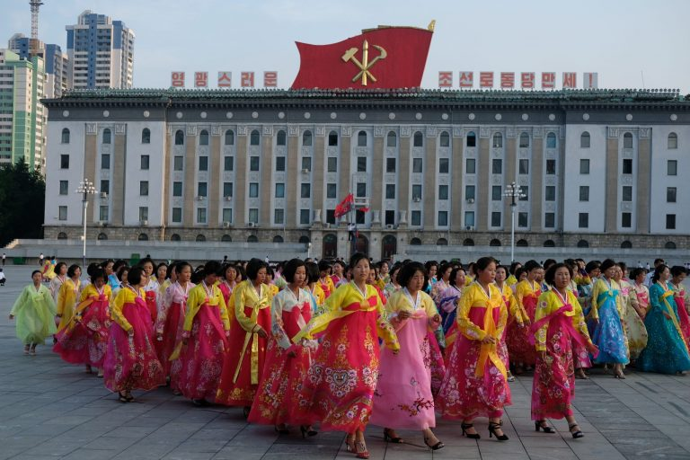 Dancers leave the square in Pyongyang after a mass dance