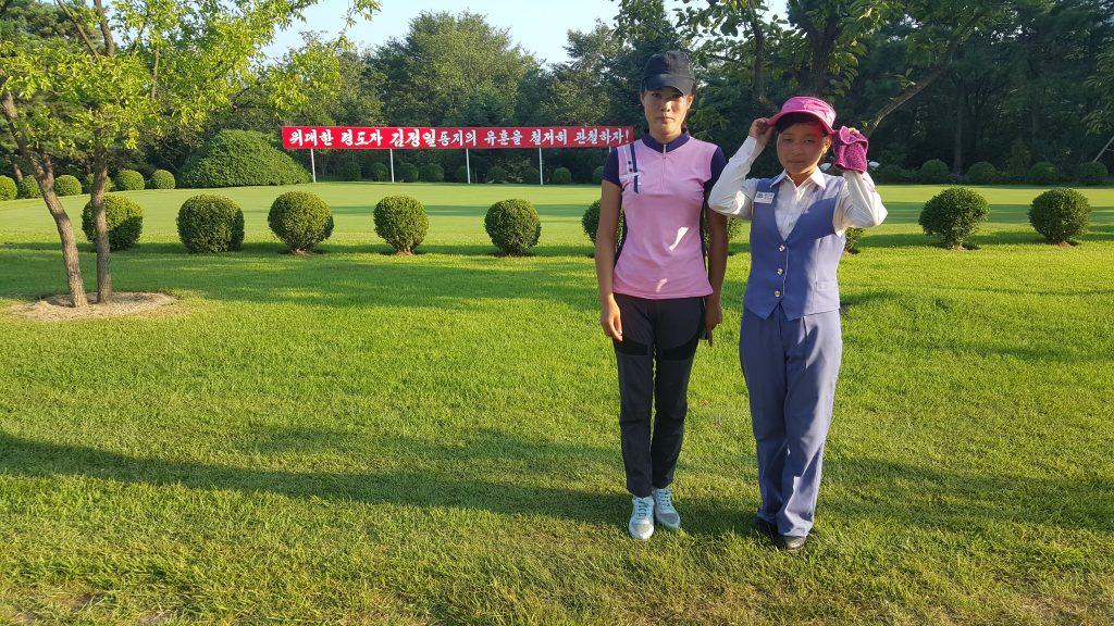 golf in North Korea. Female caddies, North Korea