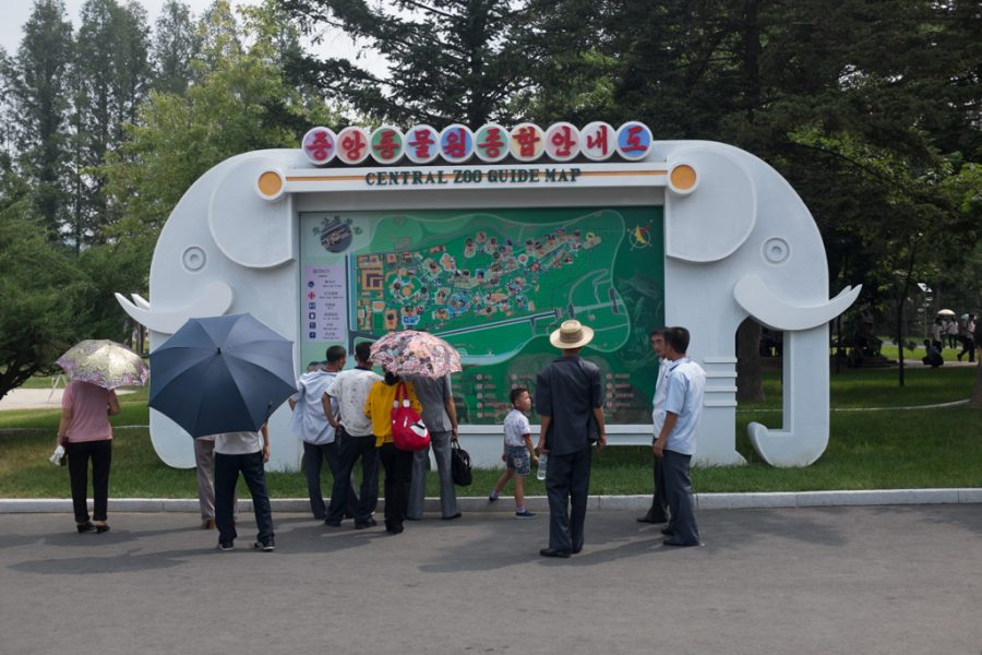 Locals looking at a map of Pyongyang Zoo