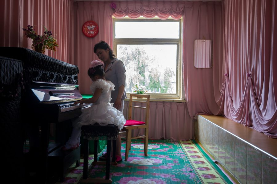 Child learning piano in Chongjin, North Korea