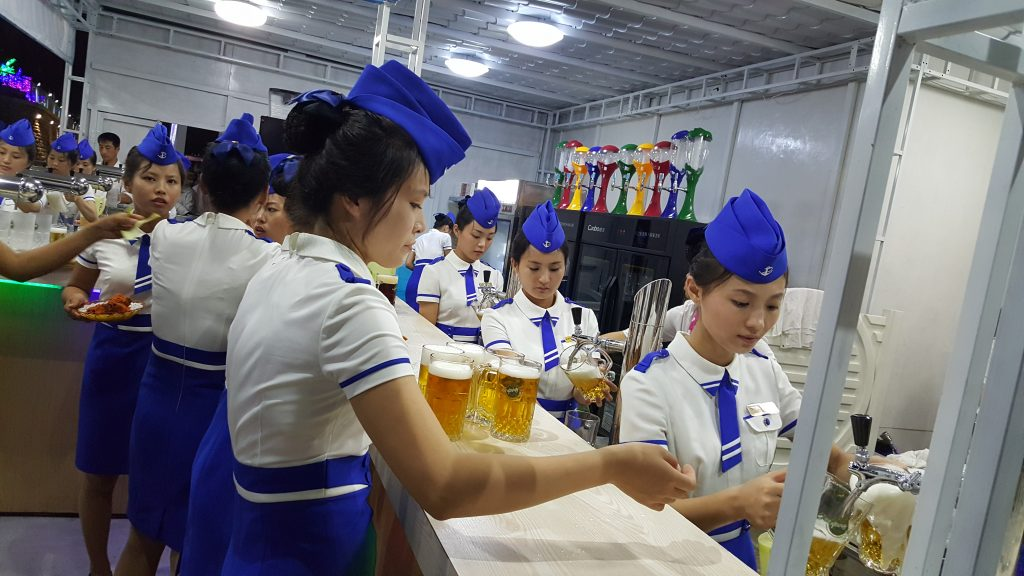 staff at a beer festival in Pyongyang, North Korea