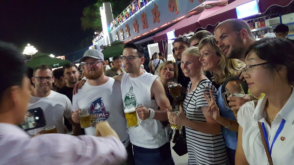 tourists at the Pyongyang beer festival on a North Korea tour