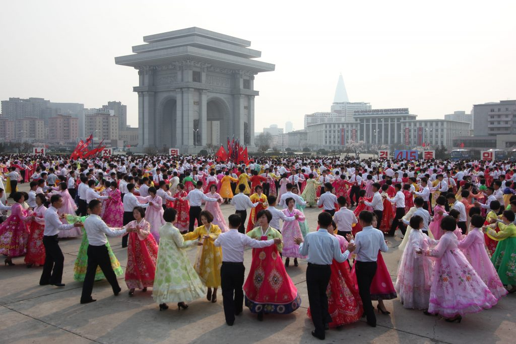 North Koreans dance next to the arch of triumph on April 15th, birthday of Kim Il Sung.