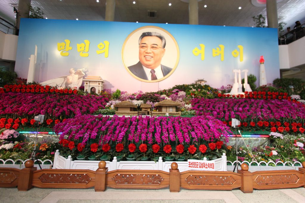 Kim il Sung seen over Mangyongdae birthplace at the Kim Ilsungia flower show