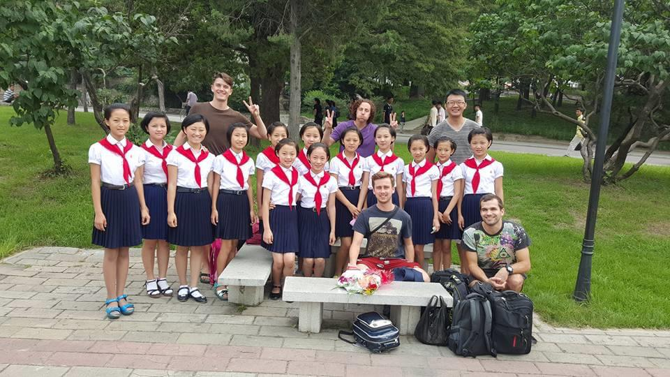 North Korean schoolkids with tourists on a North Korea tour