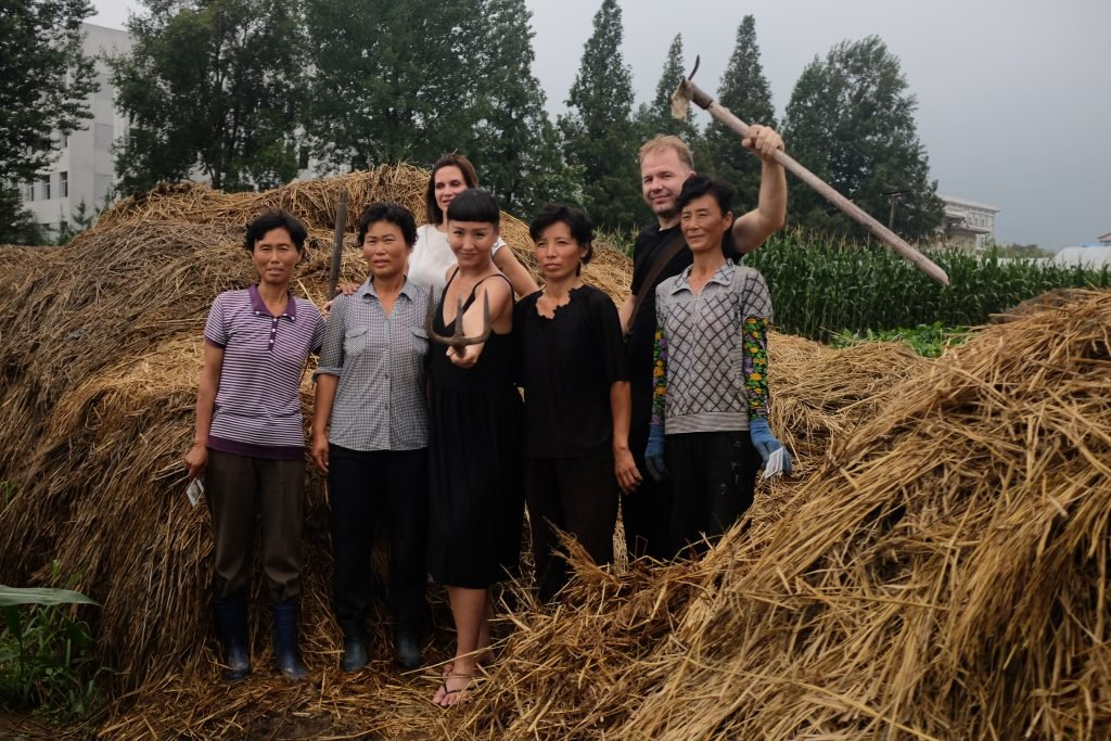 our group hanging out with North korean farmers on a DPRK tour
