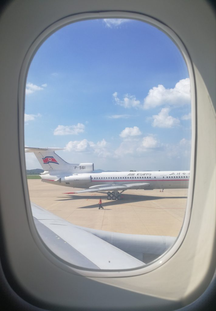 Arriving in Pyongyang airport looking at air Koryo outside the window