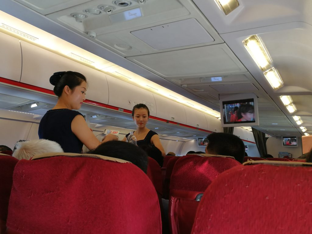 Air Koryo cabin crew serving drinks