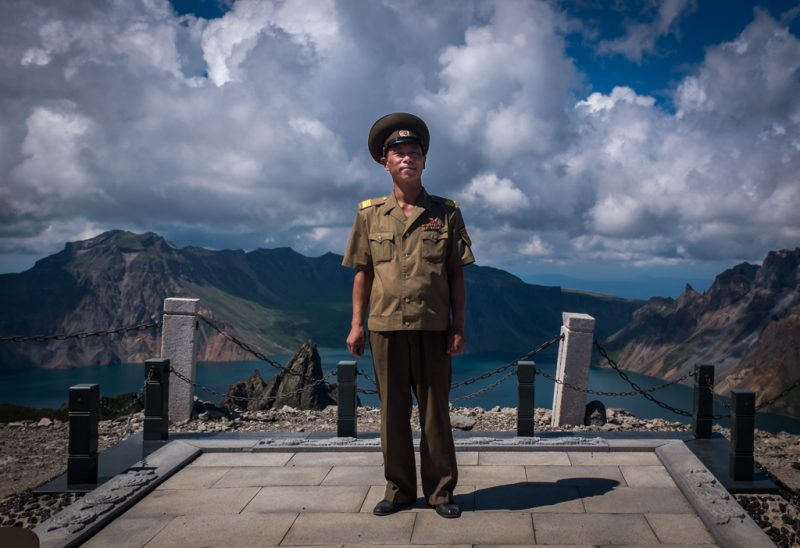 North Korean army officer posing atop Mount Paektu