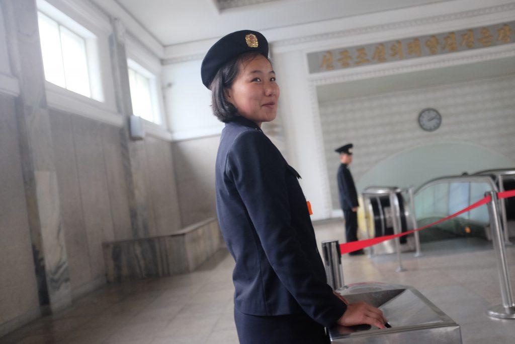 ticket collector on the Pyongyang metro, North Korea