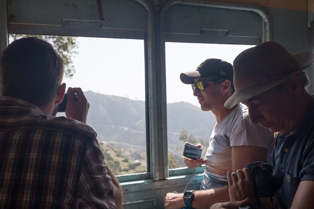 tourists riding a steam train in Eritrea