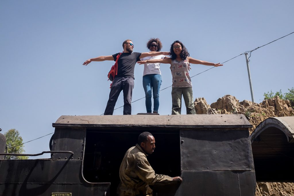 Tourists on top of the Eritrean steam train