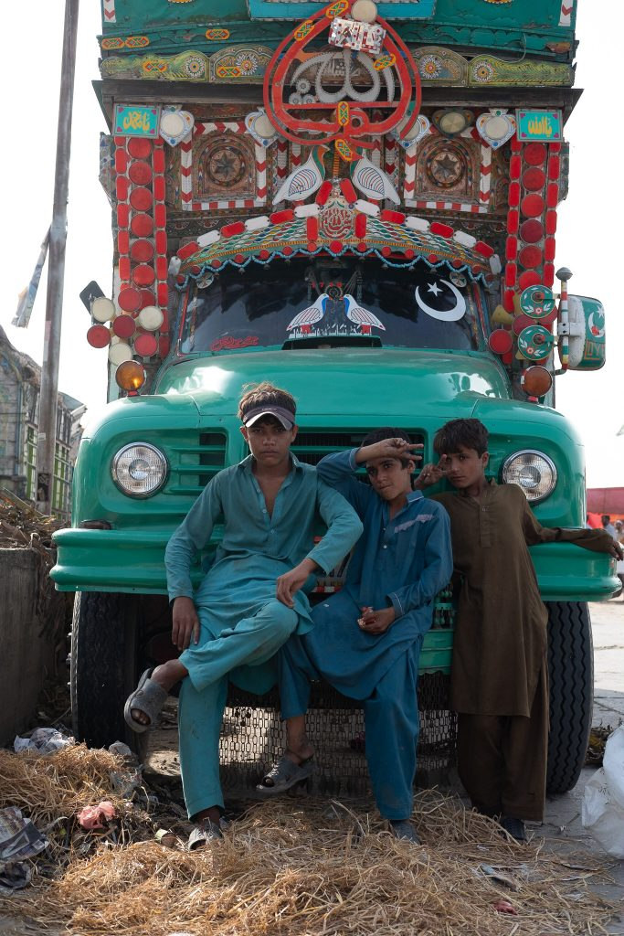 Kids with a painted truck in Pakistan