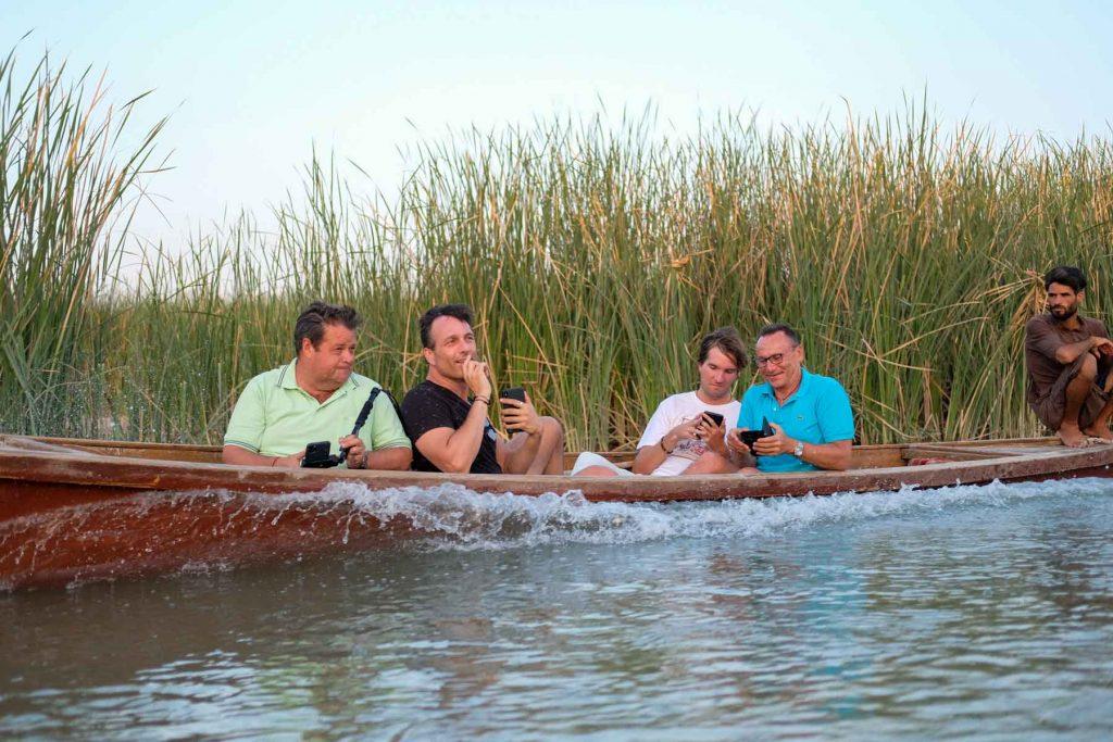 tourists enjoying a boat ride in the Iraqi marshlands